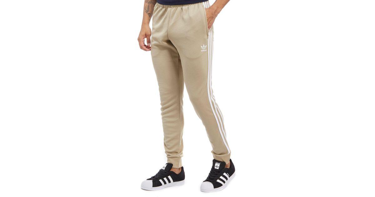 Lyst - adidas Originals Superstar Poly Track Pants in Natural for Men 8b6e17df336d