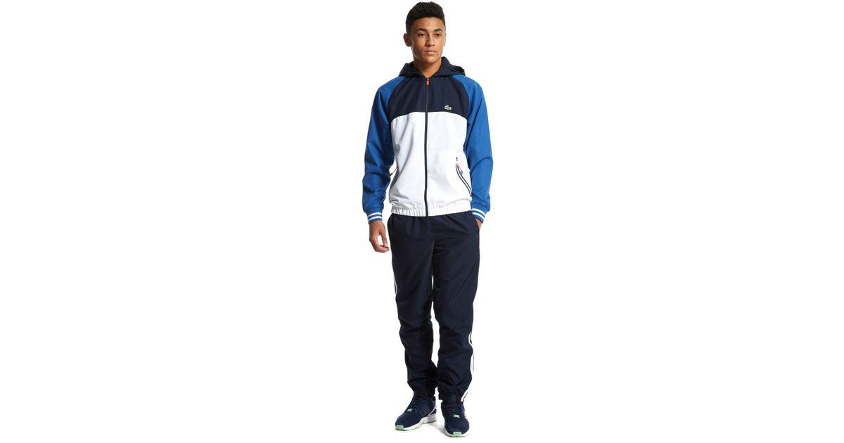 6e5ddeecc Lacoste Colour Block Hooded Tracksuit in Blue for Men - Lyst
