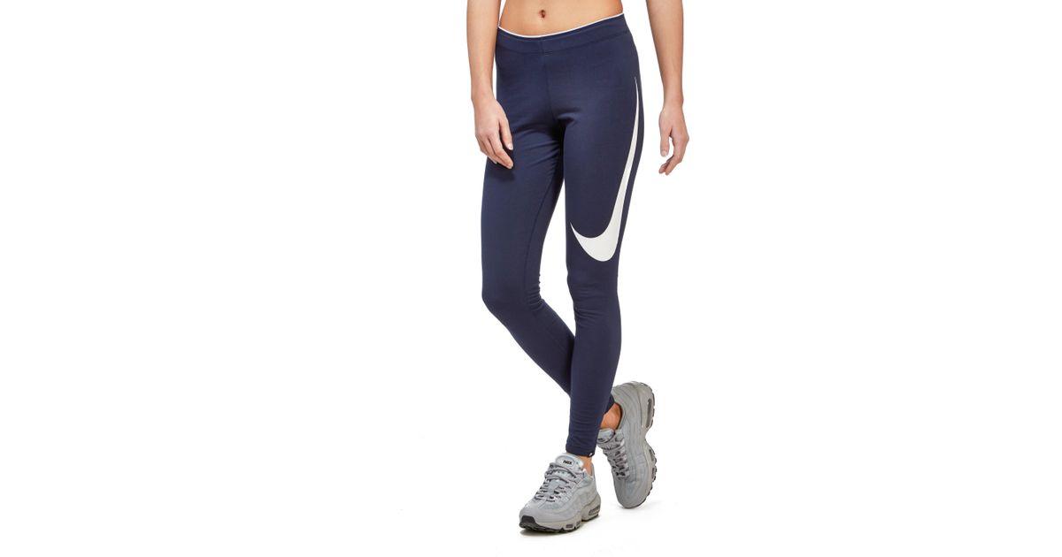 9084dd87a9d Lyst - Nike Club Swoosh Leggings in Blue