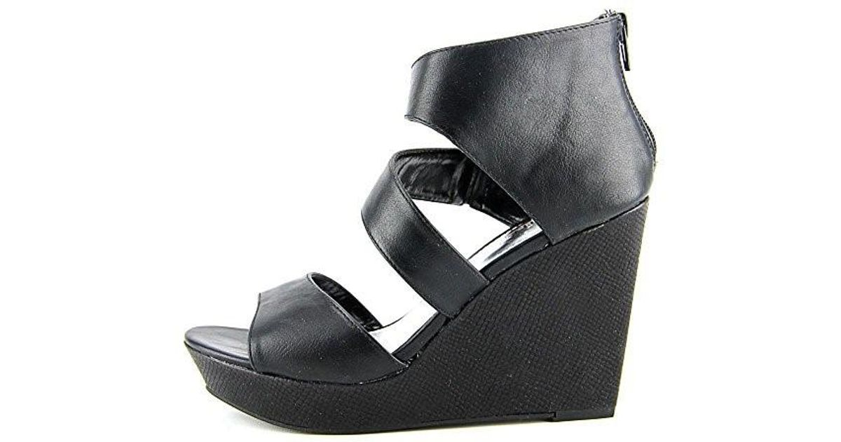 8ea3888095e Lyst - Kenneth Cole Unlisted Kenneth Cole Day Dream Platform Wedge Sandals  in Black