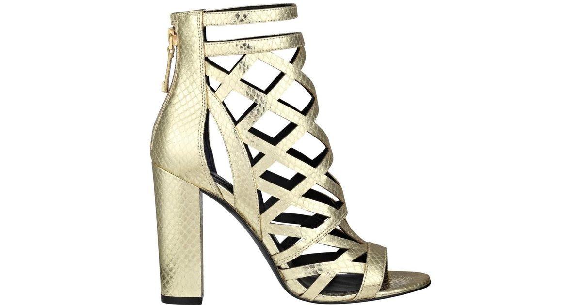 d62dc4e92245 Lyst - Guess Eriel Caged Heels