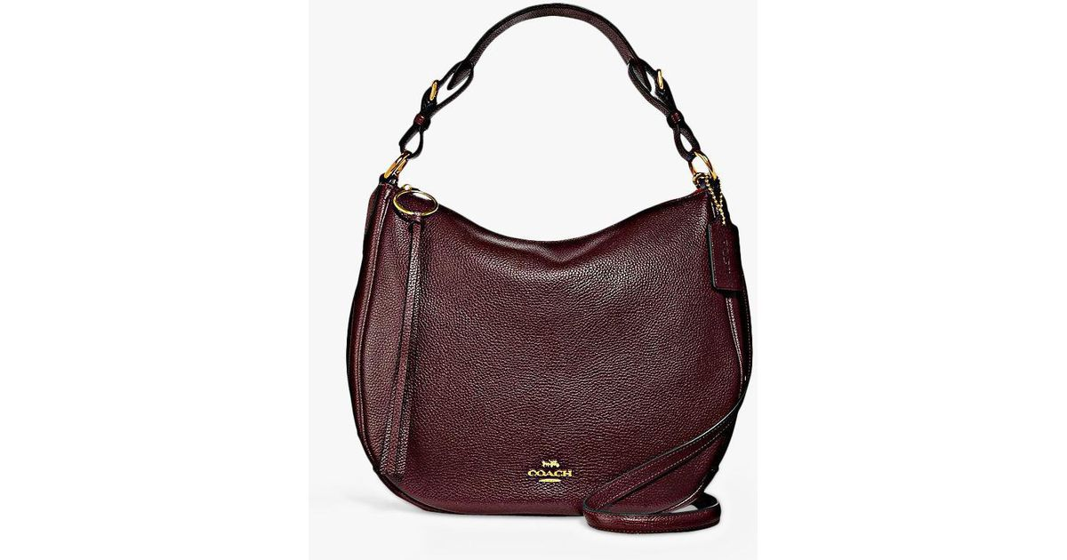 1935d9149d6 COACH Sutton Pebbled Leather Hobo Bag in Purple - Lyst