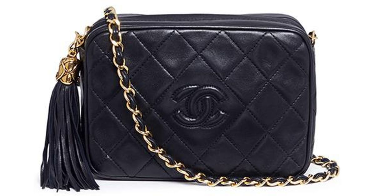 e2cc7cb2773f Lyst - Chanel Tassel Logo Quilted Leather Chain Bag in Black