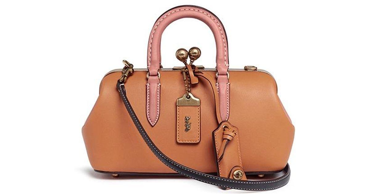 a0c091fb491c ... wholesale lyst coach kisslock satchel glovetanned leather shoulder bag  in orange 590ef 1b375