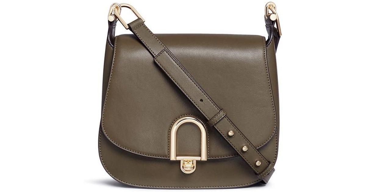 8f08ebe0734b Lyst - Michael Kors  delfina  Large Leather Saddle Bag