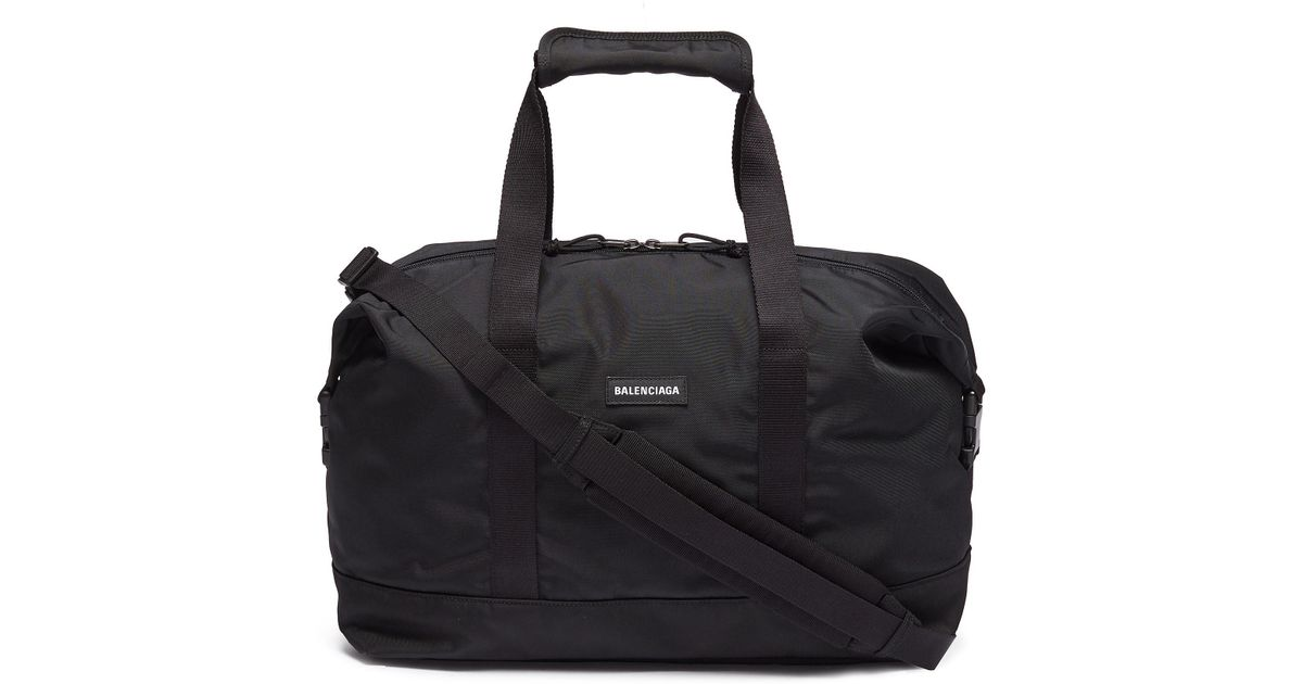 38506f3a9886 Balenciaga  explorer  Logo Patch Medium Gym Bag in Black for Men - Lyst