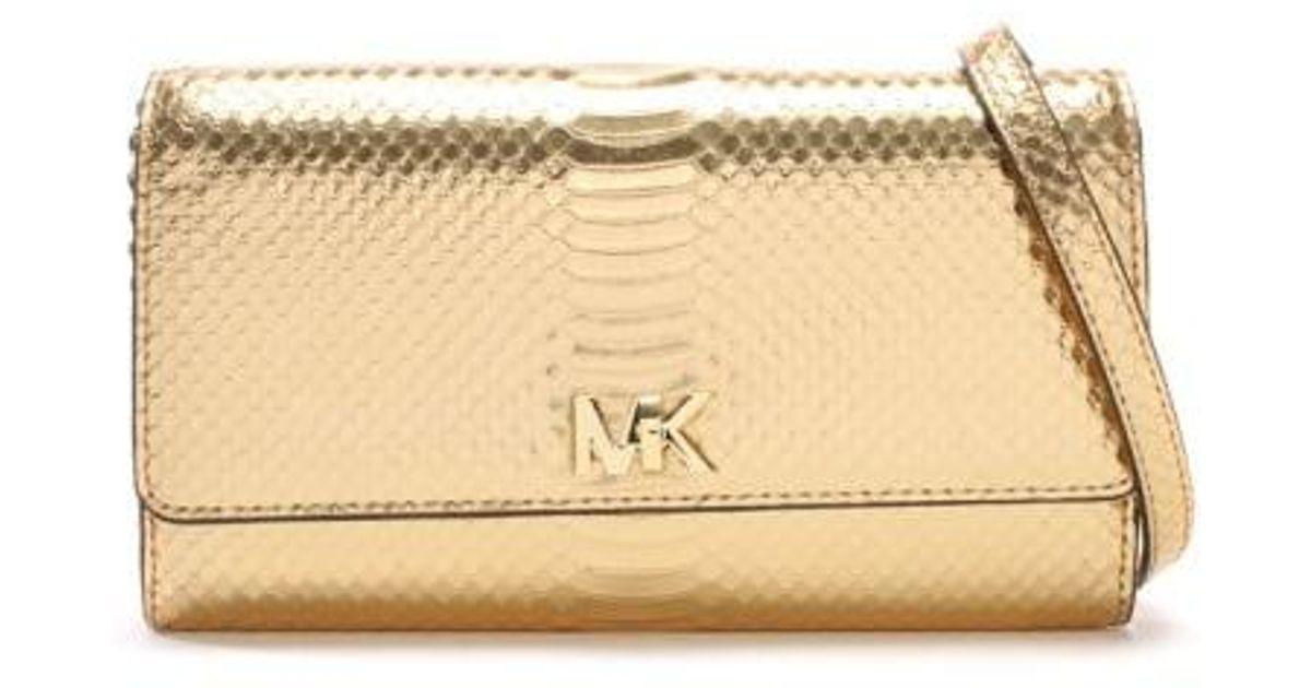a767be78d043 Lyst - Michael Kors Mott Pale Gold Reptile Leather Wallet Clutch Bag in  Metallic