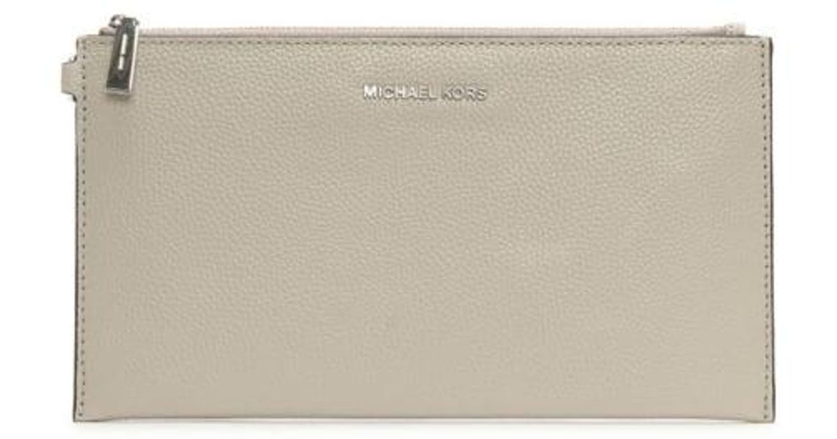 8388bfdf7321 Lyst - Michael Kors Mercer Large Cement Leather Clutch Bag in Gray