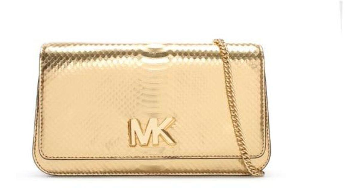 ab8e89b73edd Lyst - Michael Kors Mott Pale Gold Reptile Leather Large Clutch Bag in  Metallic