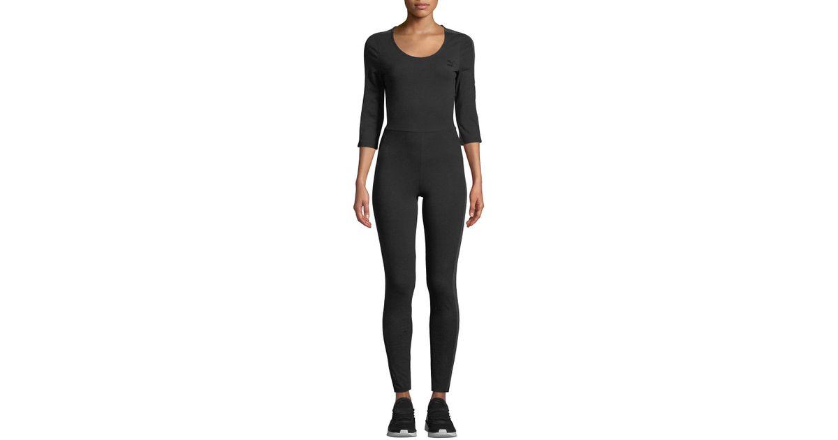 7d5138b7413b Lyst - PUMA T7 Velour Striped Jumpsuit in Black