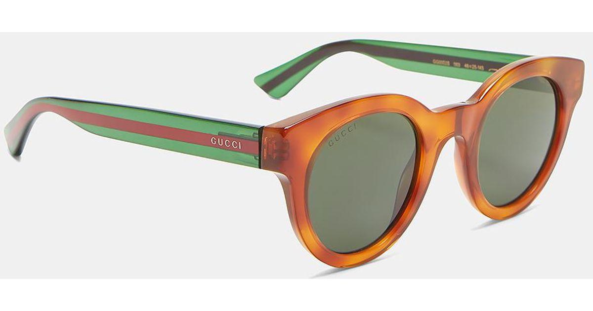 ac0cb733173 Lyst - Gucci Men s Tortoiseshell Striped Arm Round Sunglasses In Brown