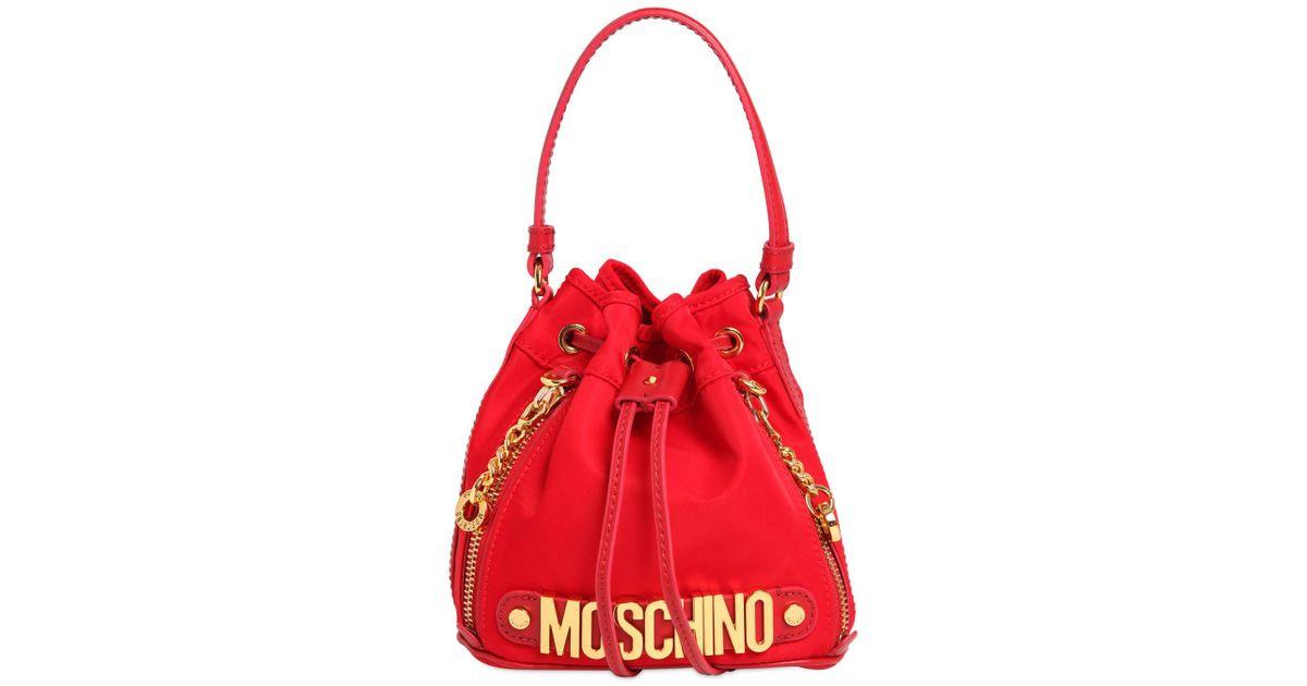 da14b7ba48662 Moschino Mini Logo Lettering Nylon Bucket Bag in Red - Lyst