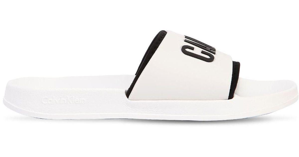 Calvin Klein LOGO PVC SLIDE SANDALS zF0soqOl