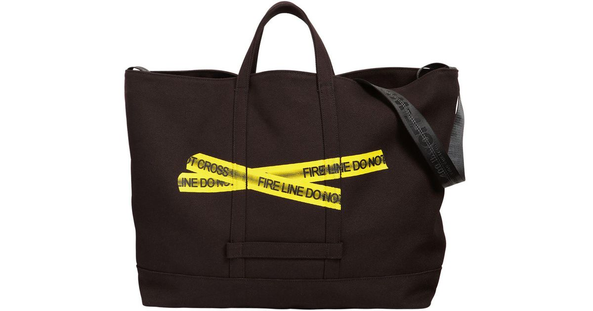 add6dc87812d Lyst - Off-White c o Virgil Abloh Fire Line Tape Canvas Tote Bag in Black