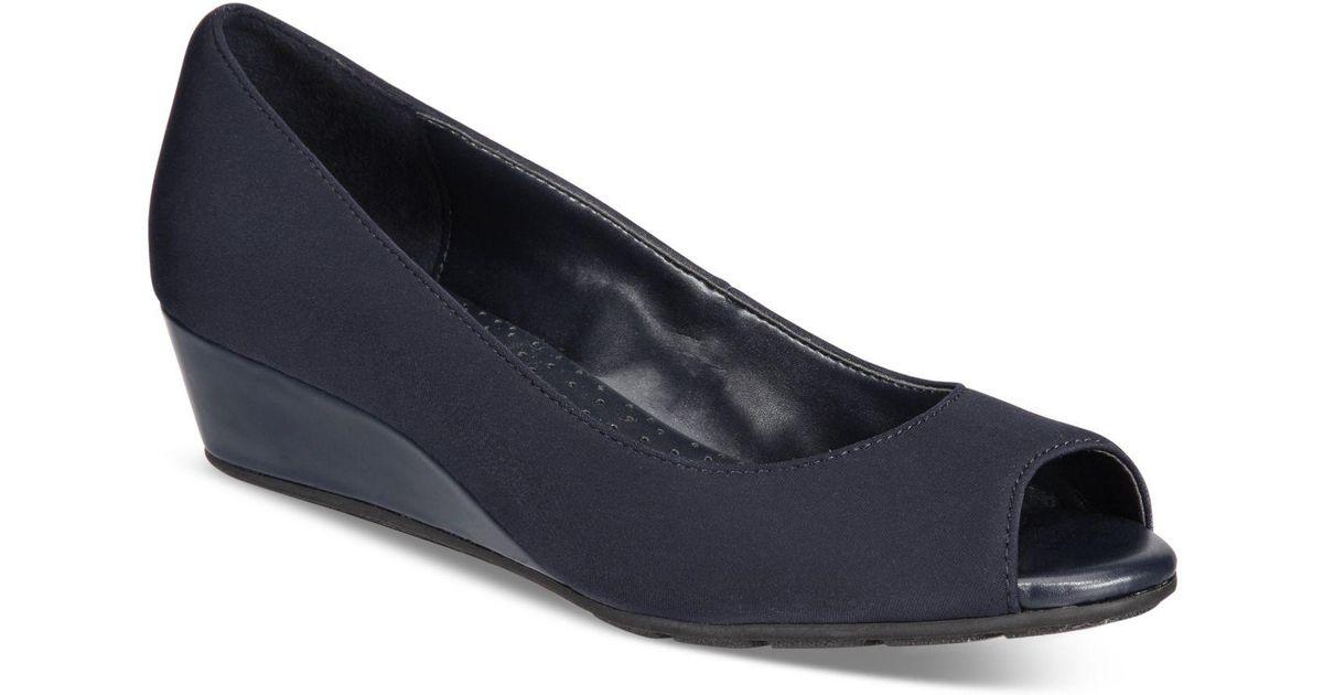 c58763c65d48 Lyst - Bandolino Candra Peep-toe Wedge Pumps in Blue
