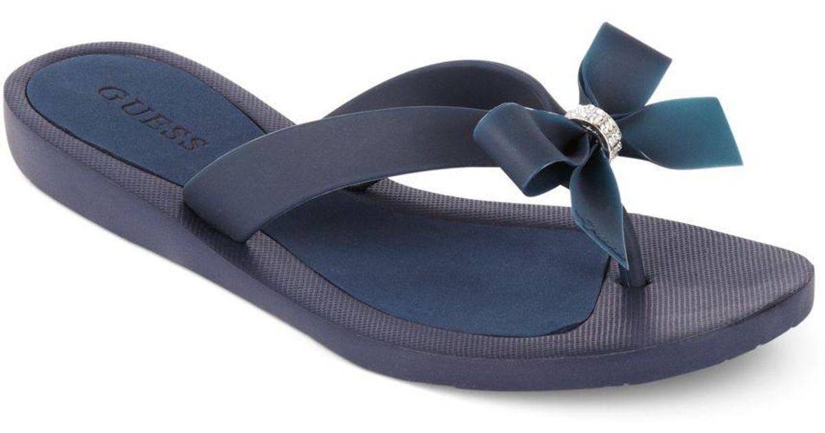 625610a7f4e48 Lyst - Guess Tutu Bow Flip Flops in Blue