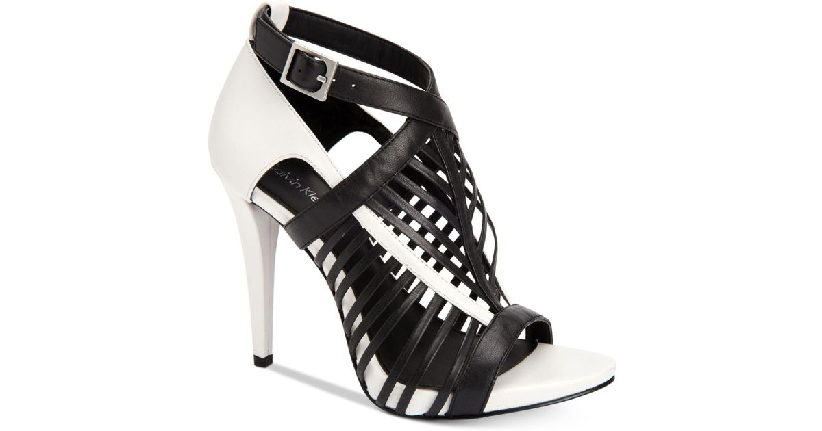 3efc2518a2e Lyst - Calvin Klein Women s Naida Caged Sandals in Black