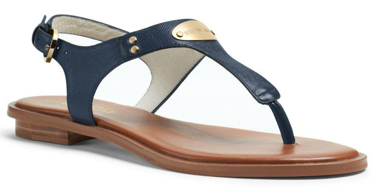2230779c283 Lyst - Michael Kors Mk Plate Flat Thong Sandals in Blue