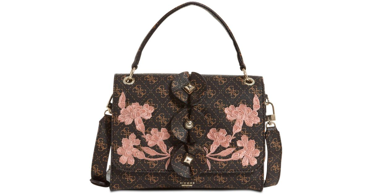 e08c4cbdb0 Lyst - Guess Eden Embellished Top-handle Small Flap Bag in Brown