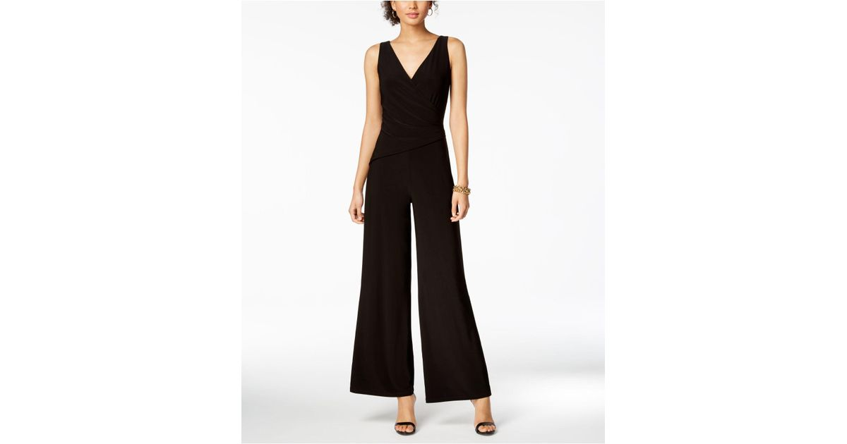 0908e294eff Lyst - Nine West Surplice Stretch Jumpsuit in Black