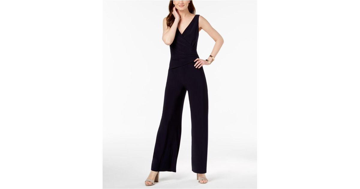 924825beaf7 Lyst - Nine West Surplice Stretch Jumpsuit in Blue