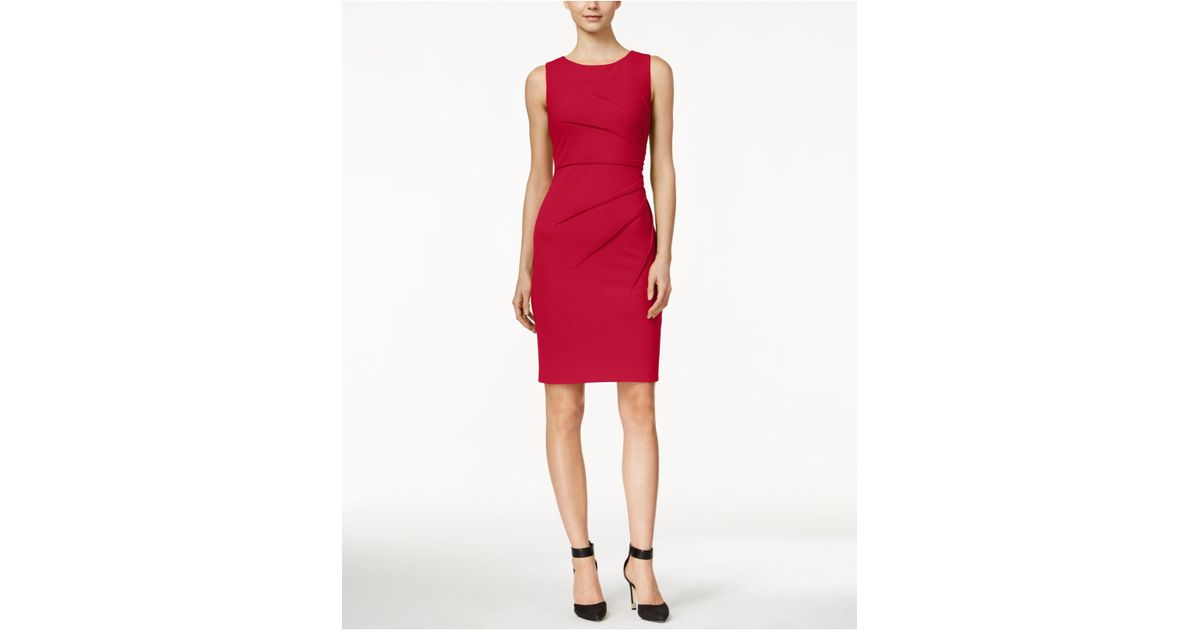 8470c5d3a6ee2 Lyst - Calvin Klein Sleeveless Sunburst Sheath Dress in Red