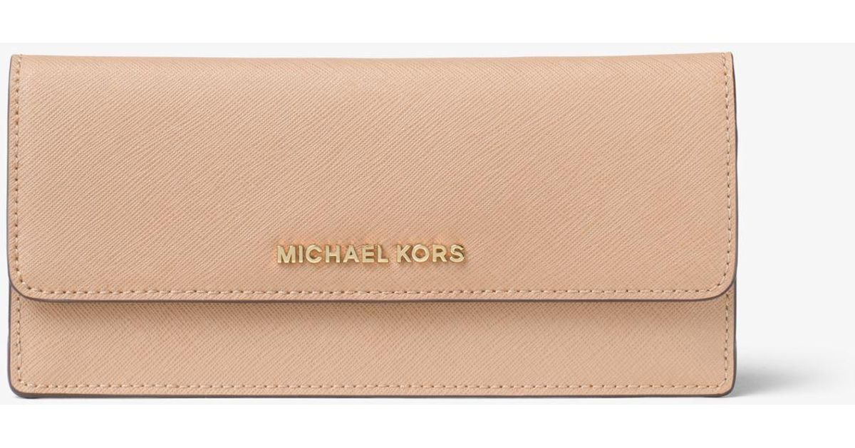 b84a5c272dc8 Michael Kors Travel Slim Saffiano Leather Wallet in Natural - Lyst