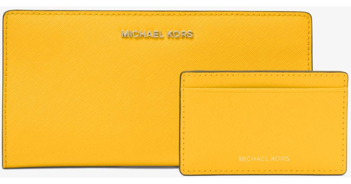 cc0aa1801fe3 Lyst - Michael Kors Large Saffiano Leather Slim Wallet in Yellow