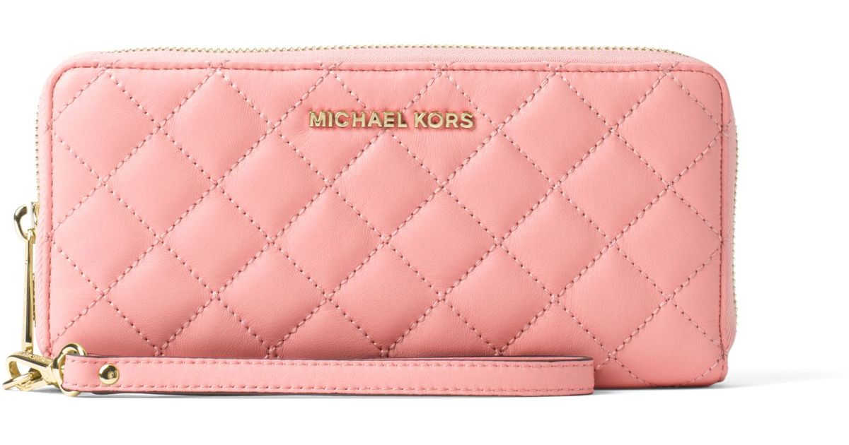 a4c54a0070a6 Lyst - Michael Kors Jet Set Travel Quilted-leather Continental Wristlet in  Pink