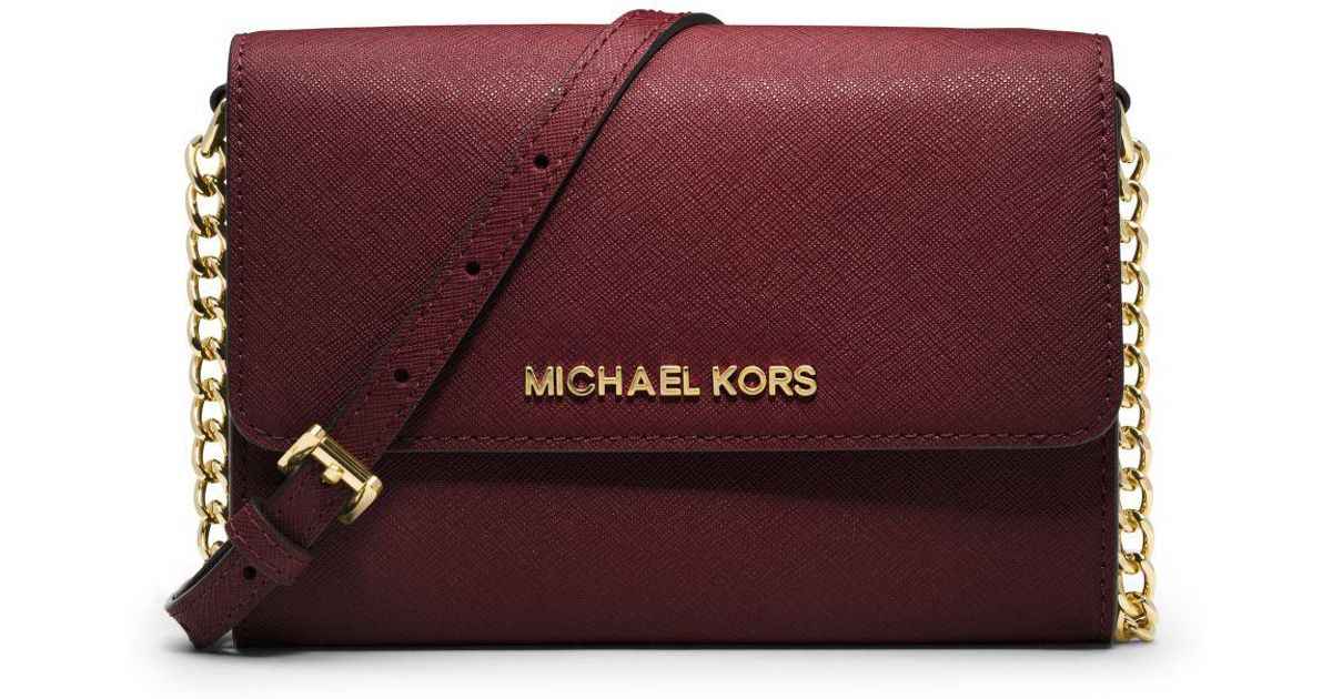311cdfd419529 Lyst - Michael Kors Jet Set Travel Saffiano Leather Smartphone Crossbody in  Red