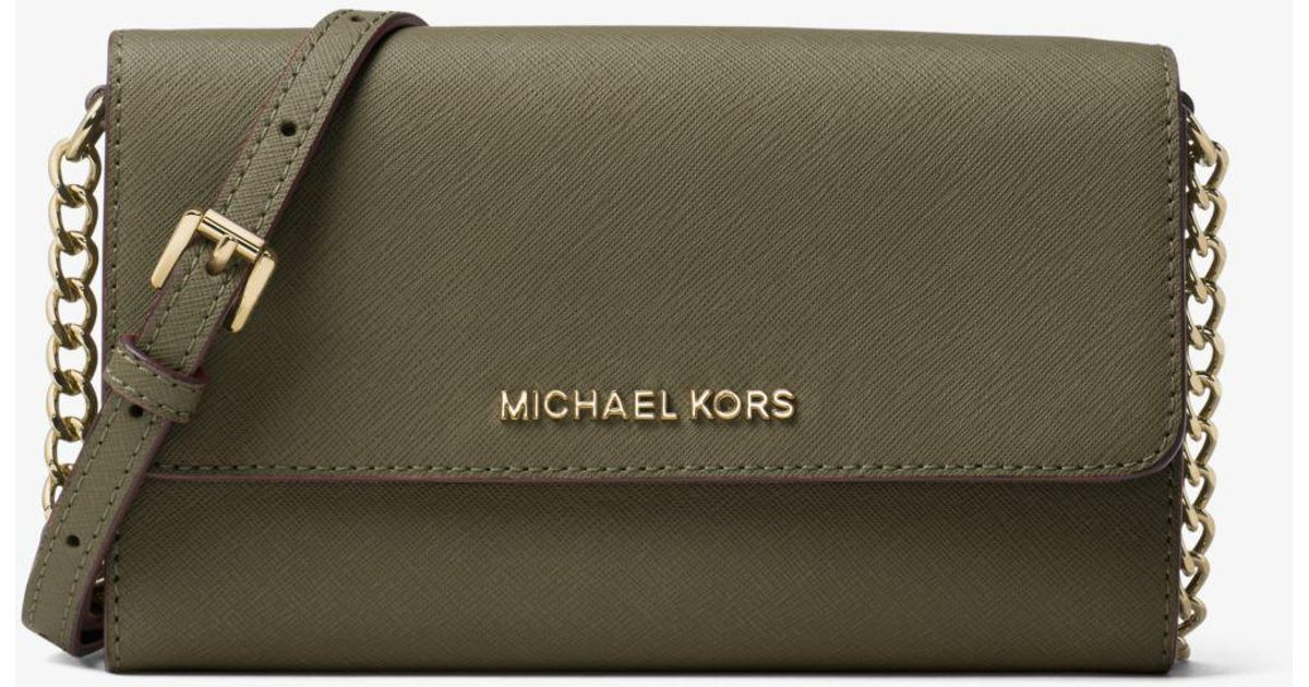 185e14bc6b3a Lyst - Michael Kors Jet Set Travel Saffiano Leather Smartphone Crossbody in  Green