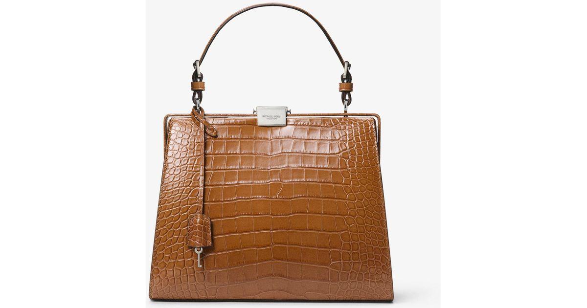 e89dfed70251 Lyst - Michael Kors Simone Alligator Top-handle Bag in Brown