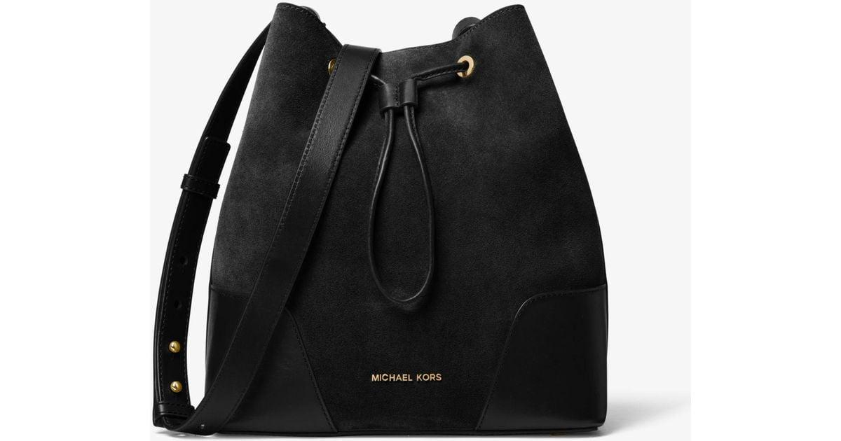 4e609e91c68c Lyst - Michael Kors Cary Medium Pebbled Leather Bucket Bag in Black