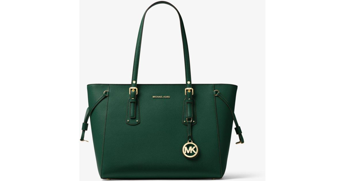 ed6da7179794 Michael Kors Racing Green Medium Voyager Tote Bag in Green - Save 24% - Lyst