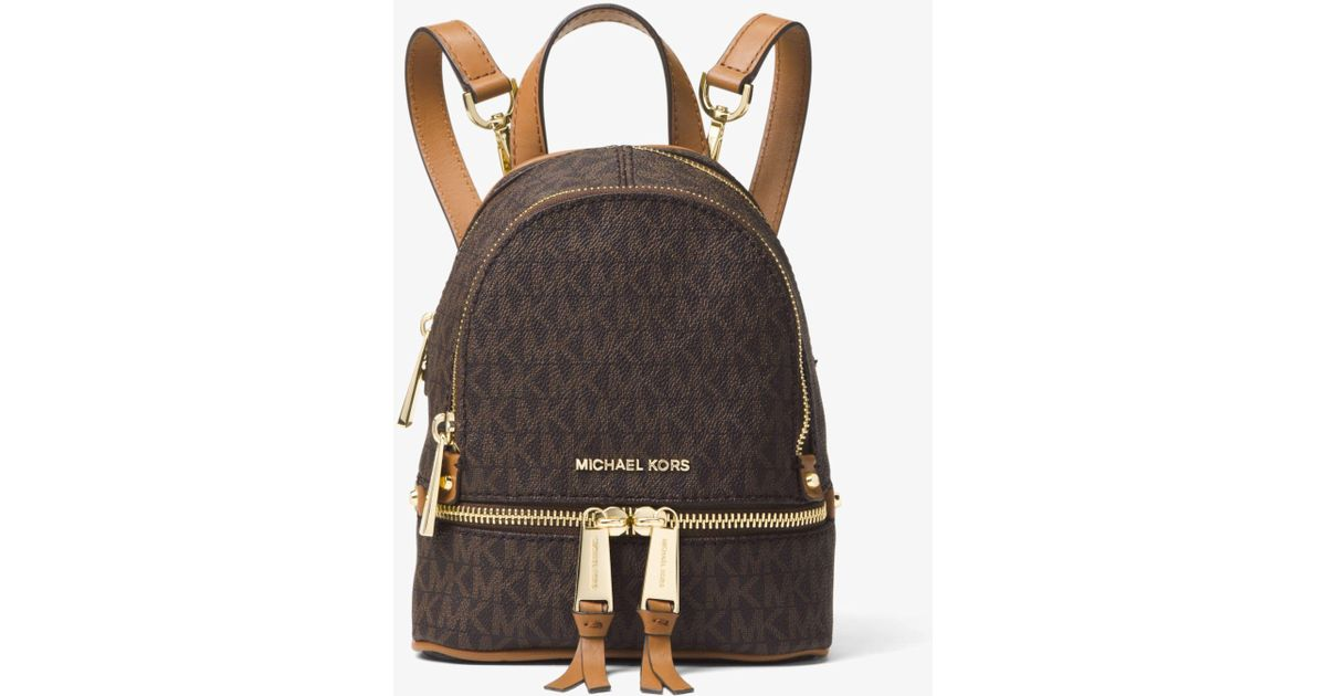 ... coupon code lyst michael kors rhea mini logo backpack in brown 5ea23  8d47a ... faa1ce331a