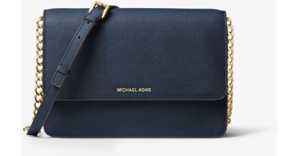 a2044a93baf1 Lyst - Michael Kors Daniela Large Leather Crossbody in Blue