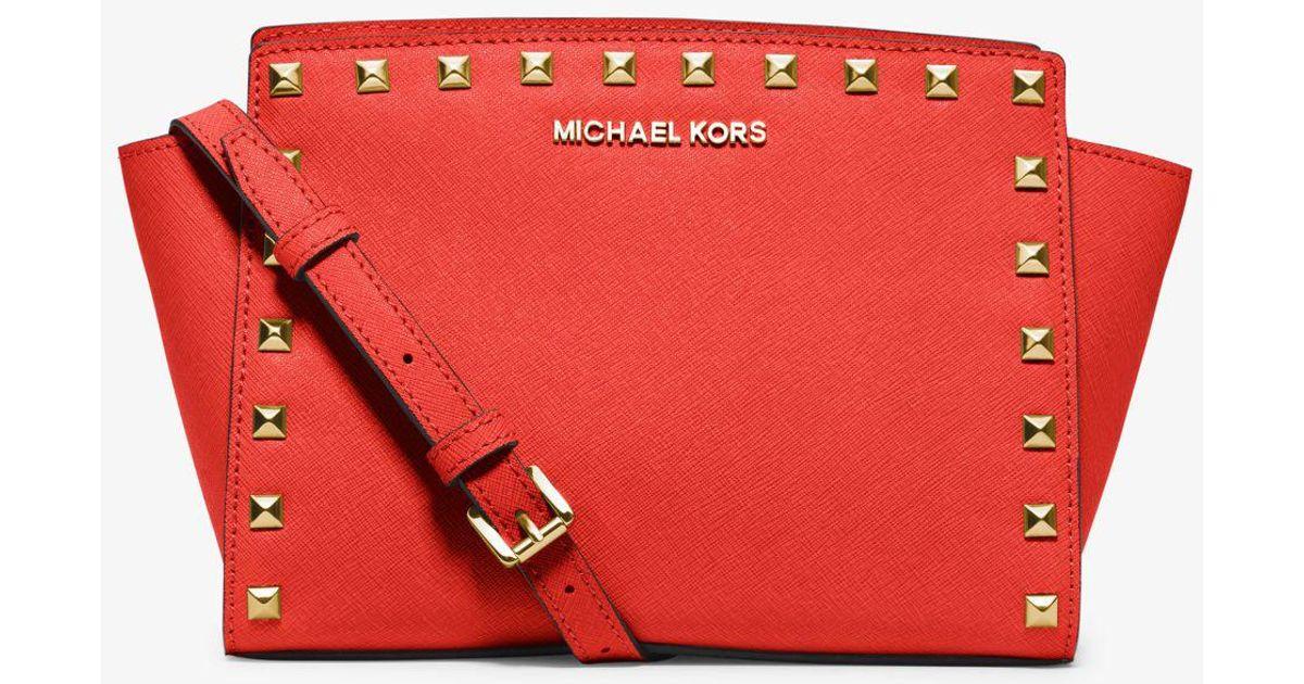 6fecebe6b310 ... inexpensive michael kors selma medium studded leather messenger in red  00736 af4aa ...