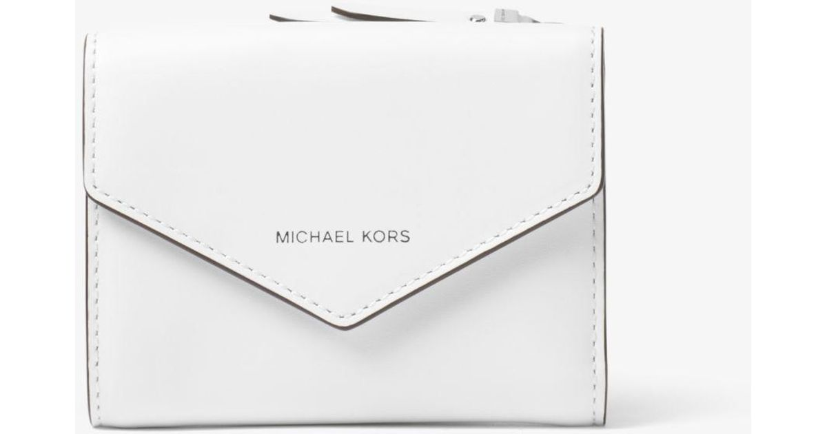 4321e50432a9 Michael Kors Small Leather Envelope Wallet in White - Lyst