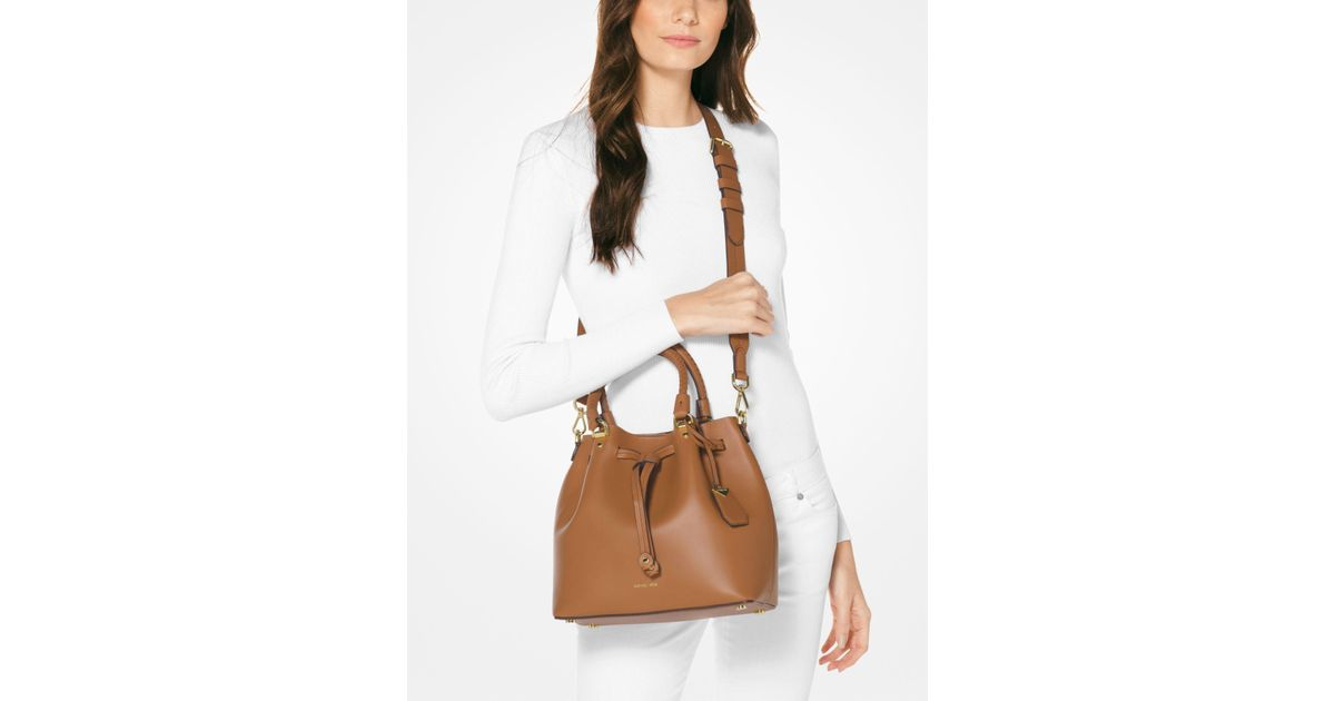 3ab1afbea3b7 Lyst - Michael Kors Blakely Leather Bucket Bag in Brown