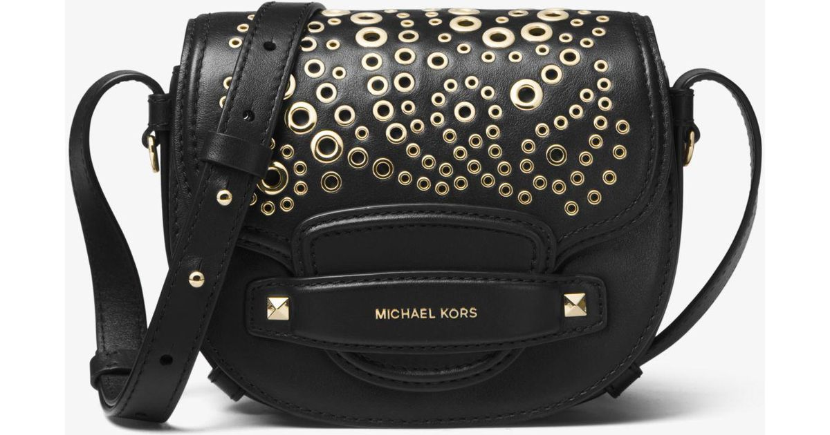 0890f9e4c711 Lyst - Michael Kors Cary Small Grommeted Leather Saddle Bag in Black