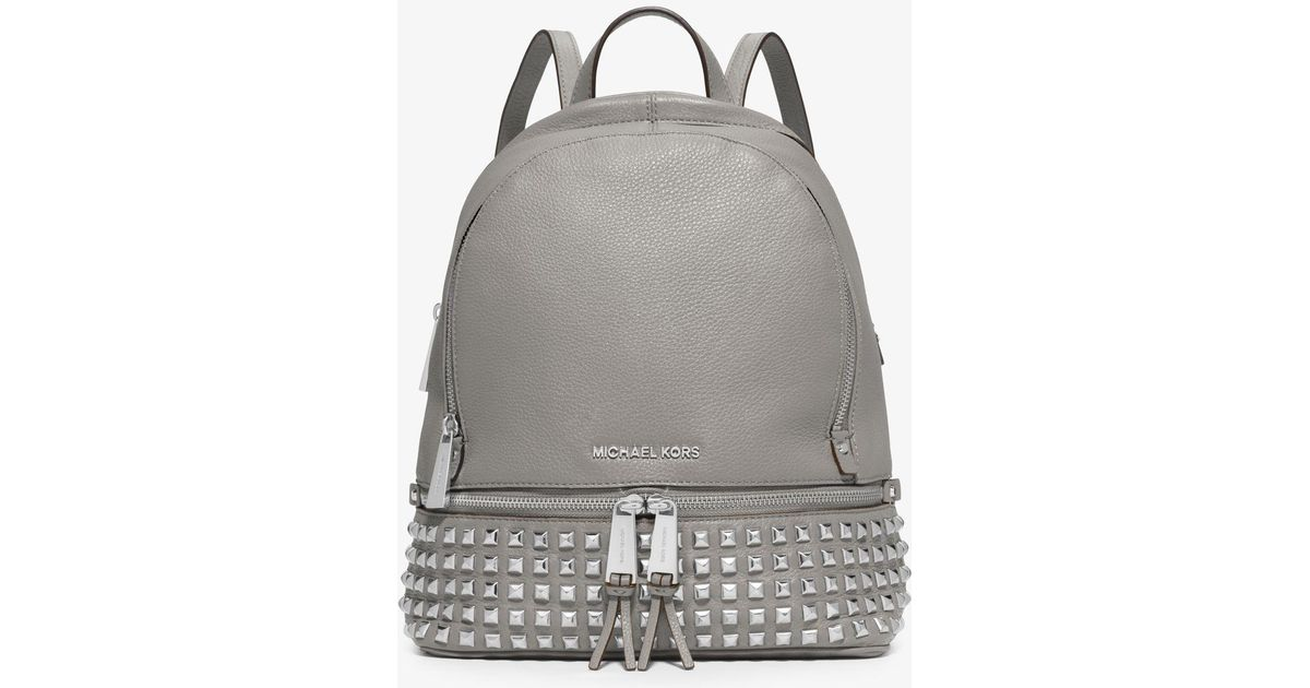 d1d0fe7c1b15c Lyst - MICHAEL Michael Kors Rhea Medium Studded Pebbled Leather Backpack in  White