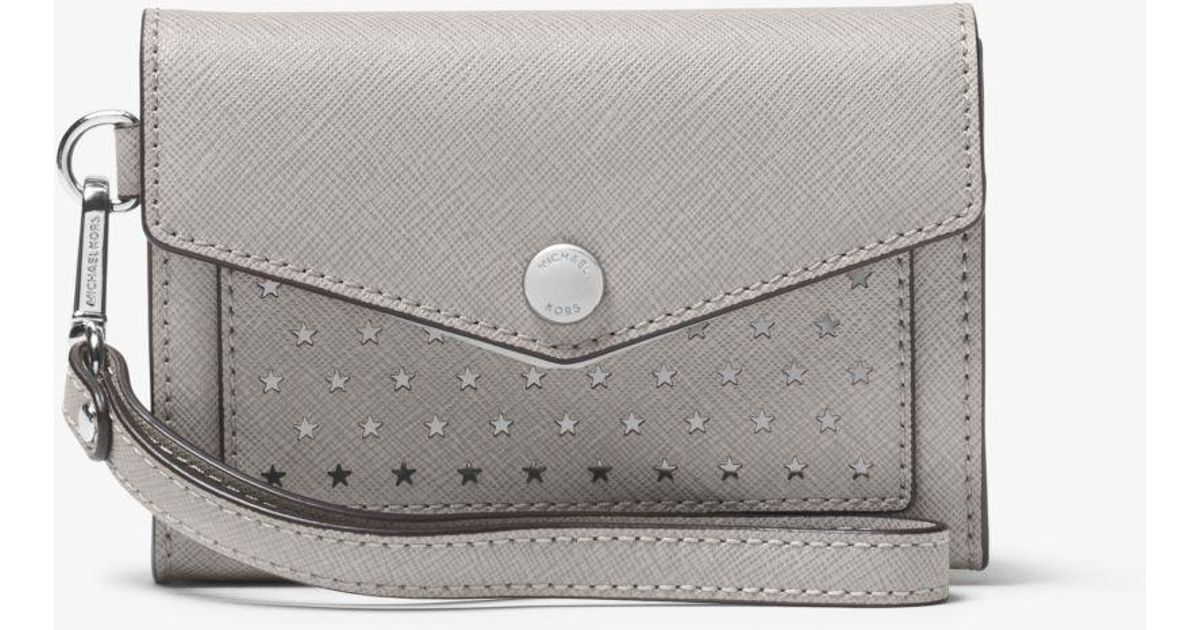 229aff2b4777 Lyst - Michael Kors Honey Perforated Leather Wristlet in Gray