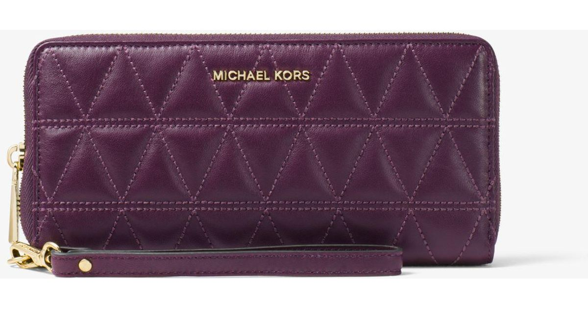 9432fcb612dd Lyst - Michael Kors Travel Quilted-leather Continental Wristlet in Purple