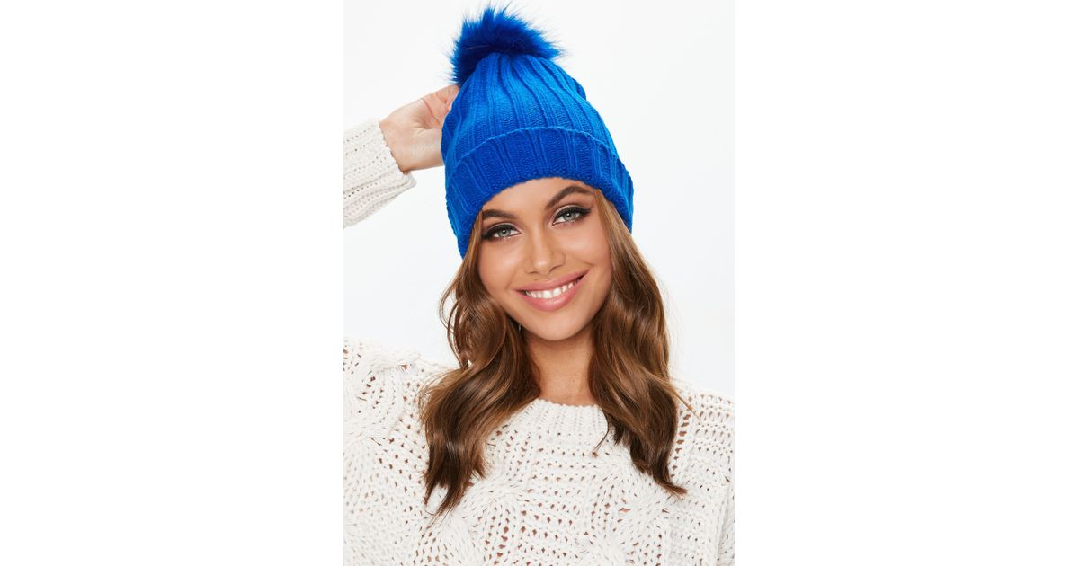 Lyst - Missguided Blue Faux Fur Pom Pom Beanie in Blue 3a677e93505d