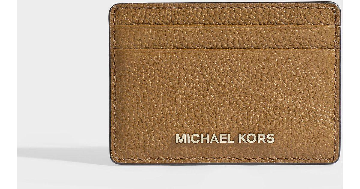 célèbre marque de designer meilleure vente Nouveaux produits Porte-cartes / porte-monnaie money pieces en cuir de veau marron MICHAEL  Michael Kors en coloris Brown