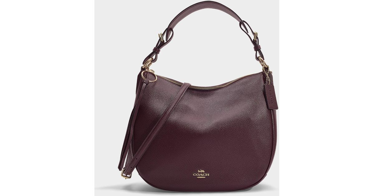 0c1956016433 Lyst - COACH Polished Pebble Leather Sutton Hobo in Red