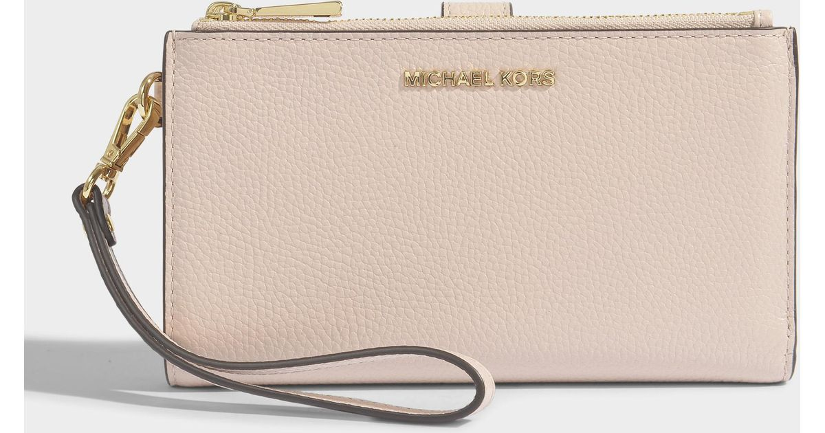 58a403f20a214 MICHAEL Michael Kors Double Zip Wristlet In Soft Pink Mercer Pebble Leather  in Natural - Lyst