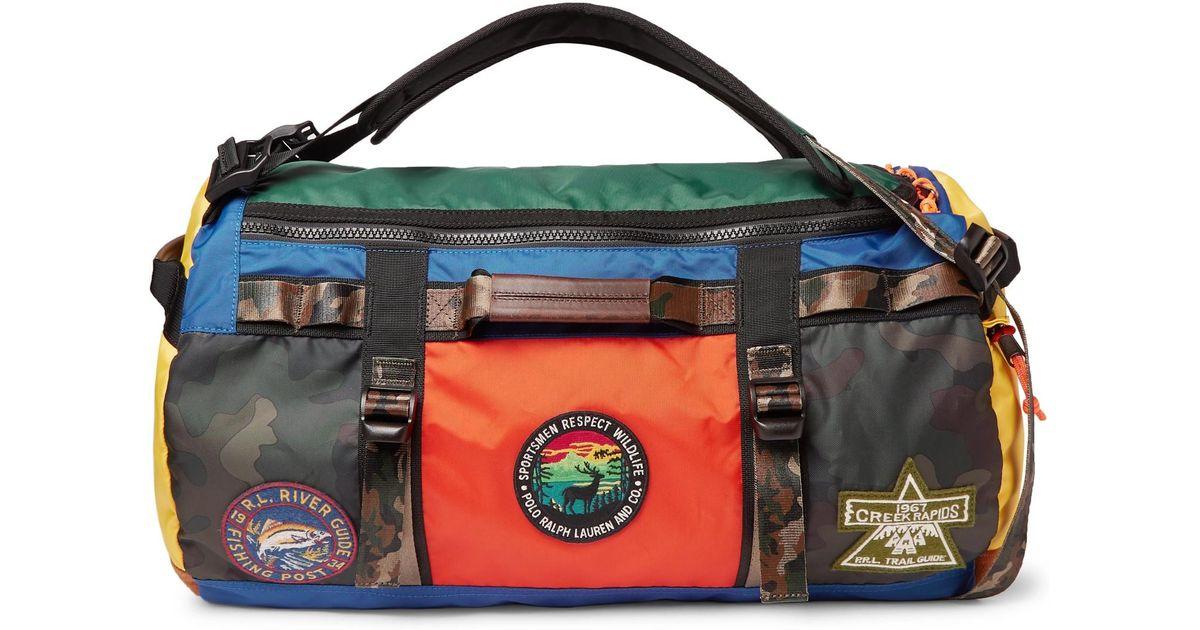 8d4c69a5e601 Lyst - Polo Ralph Lauren Appliquéd Colour-block Nylon Duffle Bag in Blue  for Men