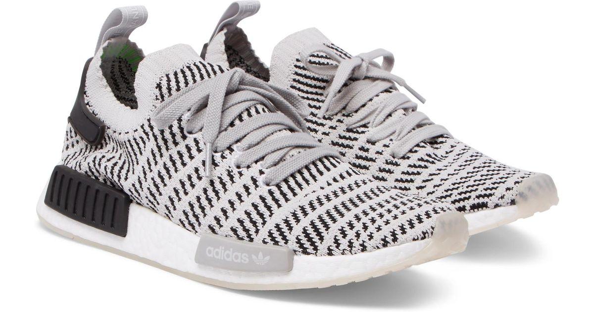 adidas originali nmd r1 stealth primeknit scarpe in grigio per gli uomini.