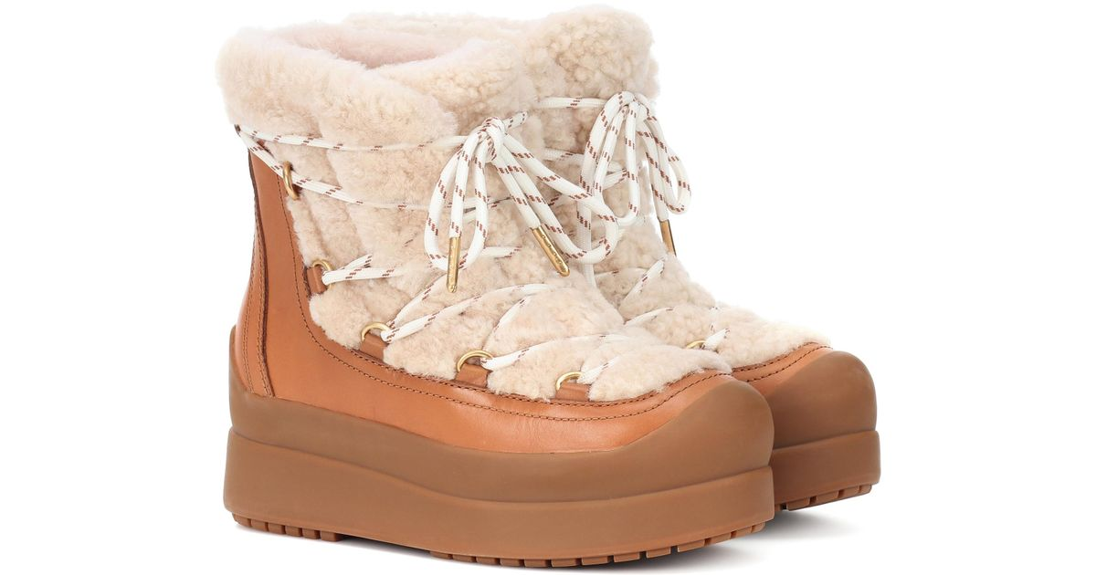 d88cafbc1b19 Lyst - Tory Burch Courtney 60mm Shearling Ankle Boots in Brown